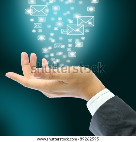 Businessman hand with email - stock photo