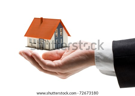 Businessman hand with model house - home concept