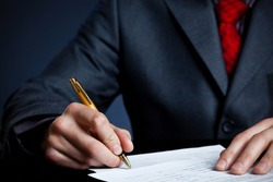 businessman hand with pen signing contract
