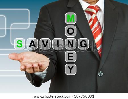 Businessman hand with text Money Saving - stock photo