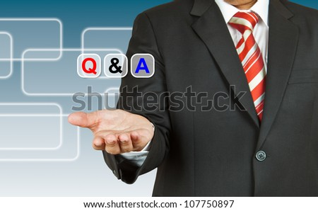Businessman hand with text Q&A