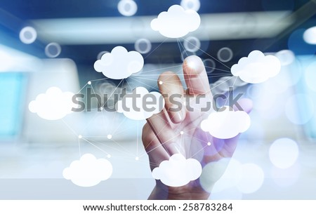 Businessman hand working with a Cloud Computing diagram on the new computer interface as concept #258783284
