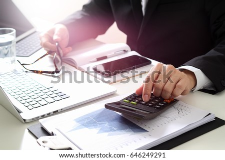 businessman hand working with finances about cost and calculator and