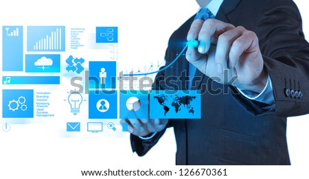 businessman hand working with new modern computer and business success as concept