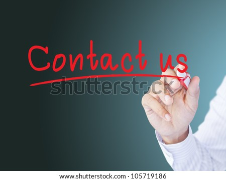 businessman hand writing contact us