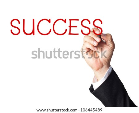 businessman hand writing success on whiteboard