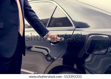 Businessman Handle Limousine Door Car