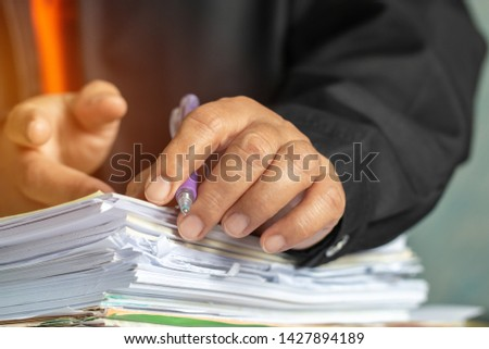 Businessman hands checking documents file paperwork financial market, searching information on work busy desk office. Piles of unfinished document achieves with pen for sigh. Business report  concept #1427894189
