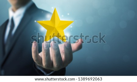 Businessman hands hold a five-star gold shape. The best excellent business services rating customer experience concept #1389692063