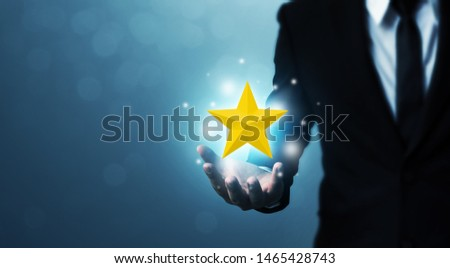 Businessman hands hold a five-star gold shape. The best excellent business services rating customer experience concept