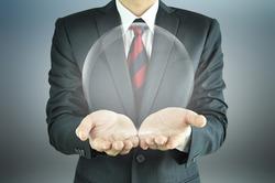 Businessman hands holding empty transparent sphere
