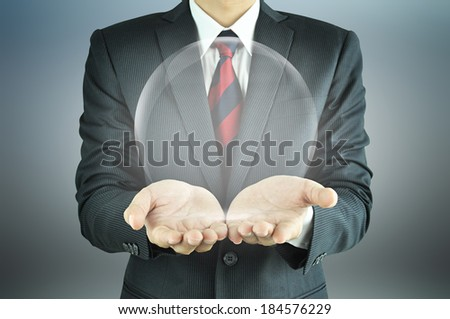 Photo of  Businessman hands holding empty transparent sphere