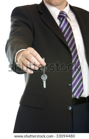 Businessman hands over key after sale of car, flat, house