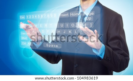 Businessman Hands pushing a button on a virtual keyboard