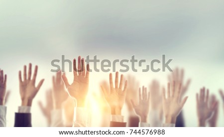 Businessman Hands raising for Participation with sunlight, Silhouette, copy space.