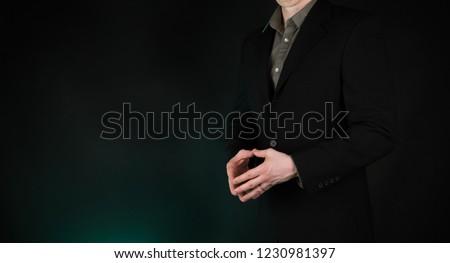 Businessman hands showing steeple superior thinking gesture, on gradient green background