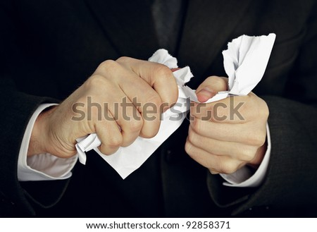 Businessman hands tormenting a document