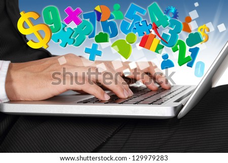 Businessman hands typing on laptop keyboard with business symbol