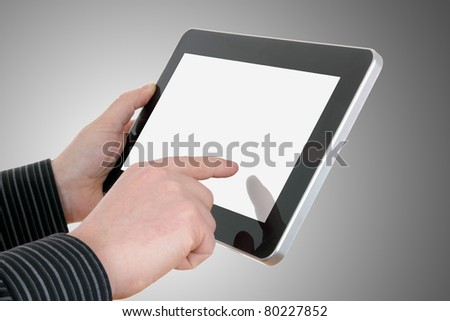 businessman hands with touch pad on grey background