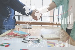 Businessman handshake for closing the deal after singing the lucrative contract between companies.Trust business partner, world map global partnership networking benchmark in meeting room concept unit