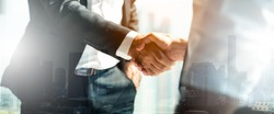 Businessman handshake for teamwork of business merger and acquisition,successful negotiate,hand shake,two businessman shake hand with partner to celebration partnership and business deal concept