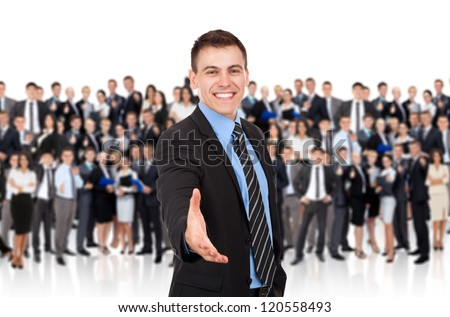 businessman handshake, hold hand welcome gesture, Handsome young excited business man happy smile shake hand over big group of businesspeople crowd background