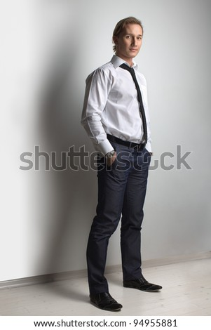 Businessman, handsome man athletic posing in studio