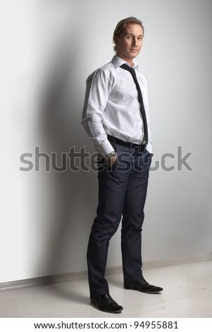 Businessman, handsome man athletic posing in studio