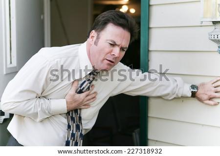 Businessman has sudden symptoms of a heart attack, angina, nausea, or illness like flu or ebola.