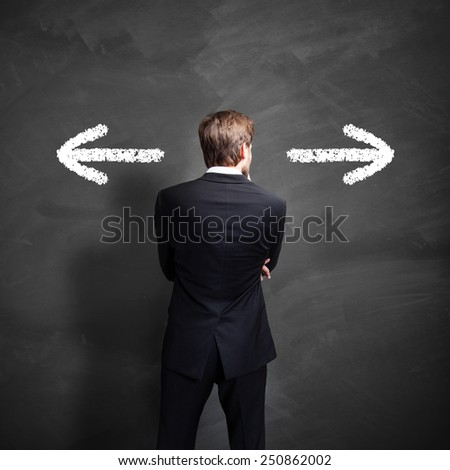 businessman has to decide between two directions Foto d'archivio ©