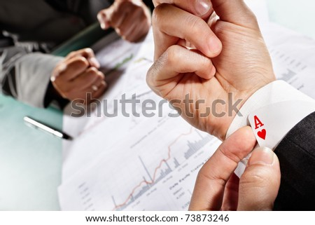 Businessman have an ace under his sleeve while meet his client or partner - stock photo