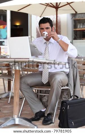 Businessman having a coffee break on a terrace