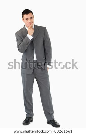 Businessman having an idea against a white background