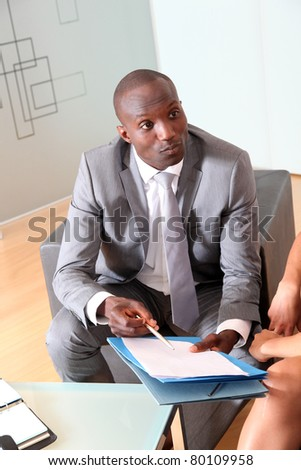 Businessman having client signing contract