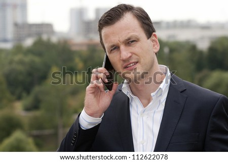 Businessman  having conversation on mobile phone