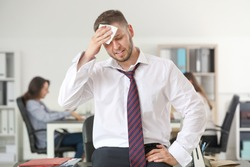 Businessman having panic attack in office