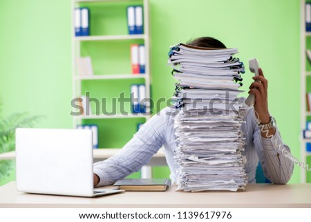 Businessman having problems with paperwork and workload