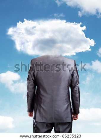 Businessman head in the clouds against blue sky