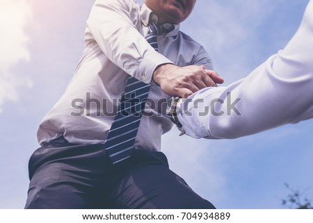 businessman Helping hand in business concept #704934889