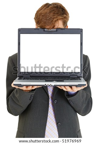 Businessman hiding behind computer screen, isolated on a white background