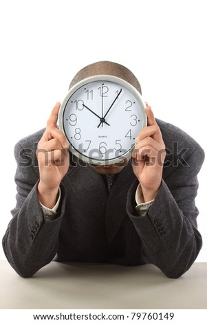 Businessman hiding behind the big clock. Time for work concept