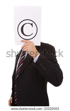 businessman hiding behind the copyright symbol