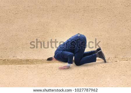 Businessman hiding his head in sand escaping from problems #1027787962