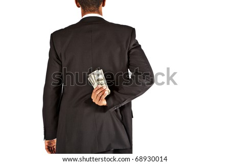 businessman hiding money behind his back
