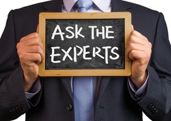 businessman hold a blackboard with words ask the experts