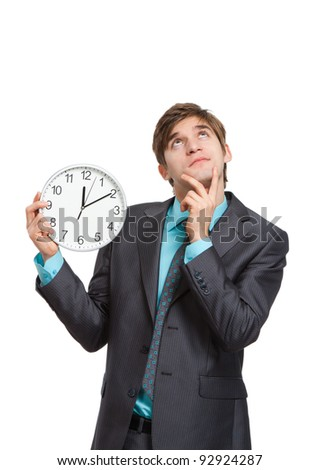 businessman hold clock think up to empty copy space, handsome young business man happy smile wear elegant suit and tie isolated over white background