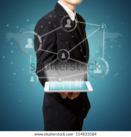businessman hold connection of social  business on tablet