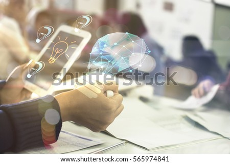 businessman hold mobile showing light bulb web engineering , Business idea concept #565974841