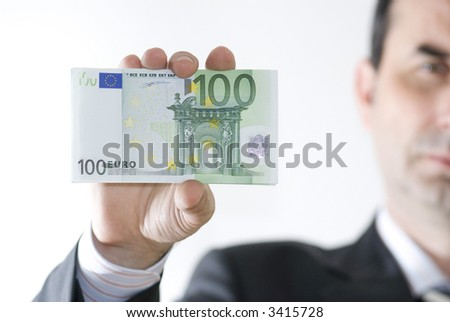 businessman hold money in hand