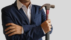 Businessman hold the hammer on white background with copy space for text,Strong tool for strategy and victory concept,weapon of marketing for business idea.